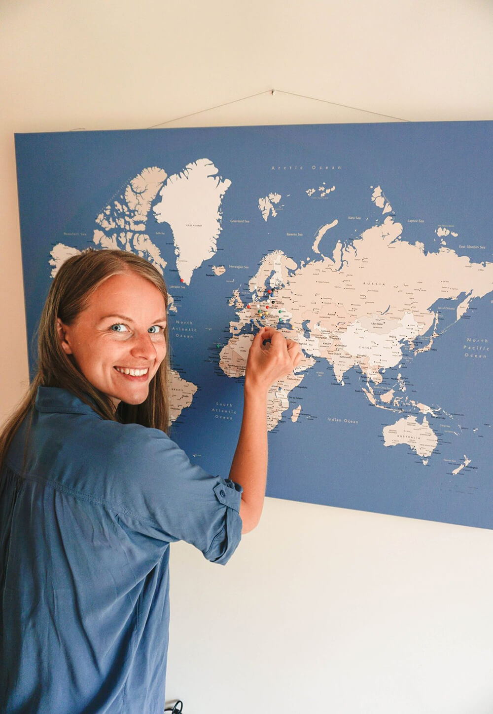 pinning world map hanged on a wire