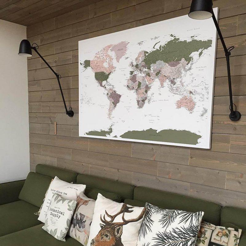green violet push pin world map hanged wall
